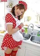 Japanese shemale Mai Ayase does a little cosplay. Playing a hot maid dressed in red fishnets and apron, Mai puts hot cream in your coffee.